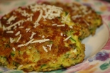 Sprinkled with extra cheese, these zucchini cakes make a great appetizer or side dish!